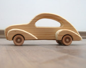Elegant toy car made of wood