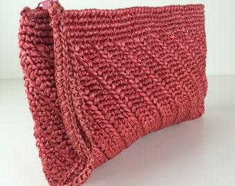 salmon pink woven raffia clutch w/ wrist strap