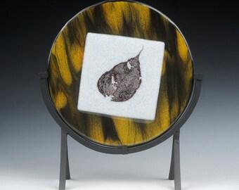 Glass sculpture with fused leaf design