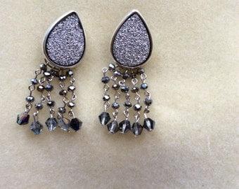 Tear studed earrings