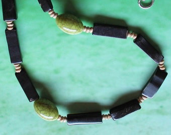 THE FORTIM NECKLACE - horn tubes. natural seed beads.polished green brindle acrylic beads.fashionable.trendy