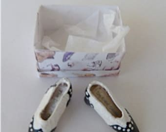 Shoes spectator pumps are black and white with a medium height heel  dollhouse miniature 1/12 scale