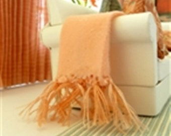 Dollhouse miniature peach colored throw with fringe.