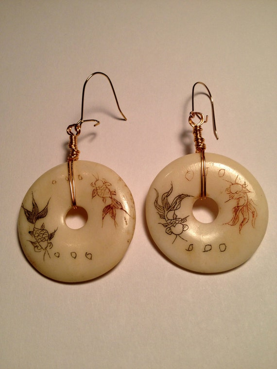 """Gold plated earrings with off white """"yin-yang"""" donuts with red and black fish"""