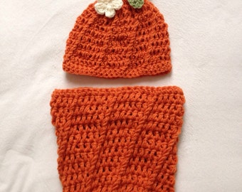 Adorable handmade crochet pumpkin cocoon with matching hat.