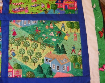 Hand Quilted Seasons Quilt with bright blue