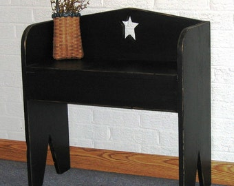 Small colonial, primitive black boot bench.