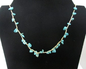 A crocheted necklace with turquoise stones