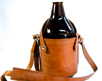 Leather, over the shoulder growler carrier.