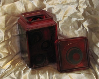Red painted glass decorative canister