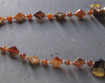 Necklace with amber inserts and silver