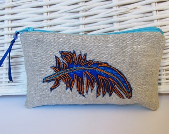 Small zip up linen purse with blue embroidered feather design