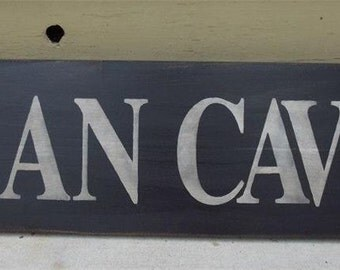 MAN CAVE   Sign  24x7.5 inches
