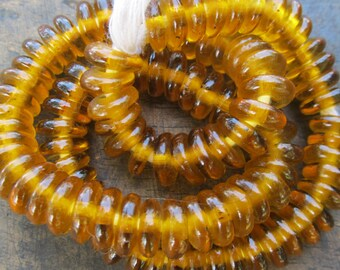 """African recycled clear glass spacer beads, """"otaaka"""", 1 strand 100 beads, amber"""