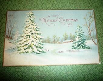 Vintage Christmas Postcard With Pine Trees and Snow