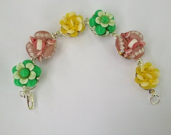 bracelet made from upcycled vintage clip earrings in bright colors for spring and summer.  Great shades of pinnk, yellow, and green