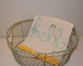 "Say ""Hello"" with this hand made ""Hello""  in light green,  Flour sack tea towel with pom pom trim"