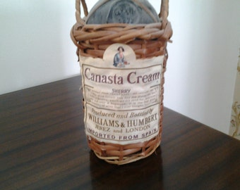 Canasta Cream Sherry bottle with basket, labels intact wicker basket wrapped