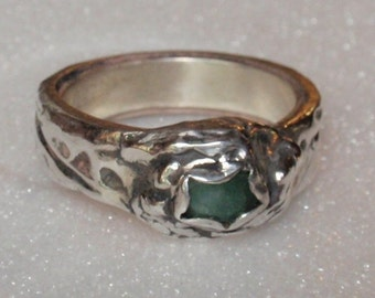 Hand modeled in Precious Metal Clay (.999 pure silver) this rugged design features a genuine natural emerald on a textured band.  Size 8