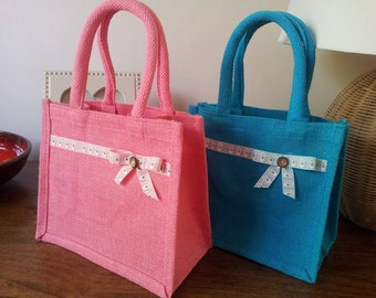 Handmade Jute lunch bag with padded handles featuring beach hut ribbon and bow