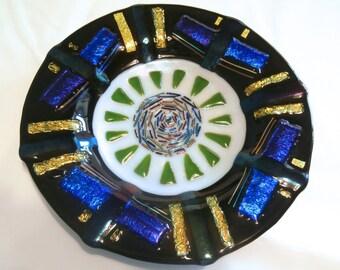 "Striking black  9"" diameter dish with dichroic glass design."