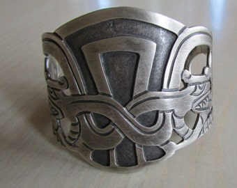 Wide Sterling Silver Bracelet from Mexico.  Horned Reptile Look