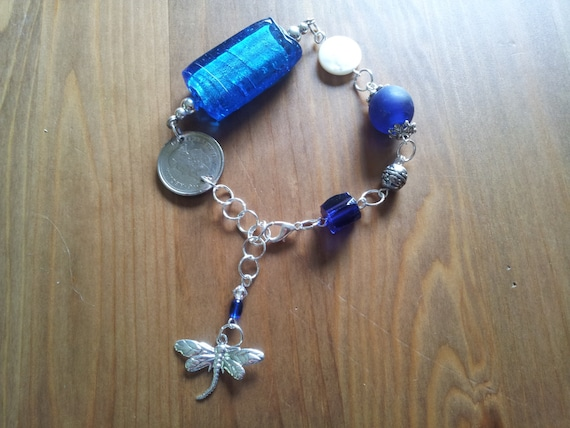 Blue Moon over Canada - Charm bracelet with Canadian Nickle and blue Glass beads - Silver Dragonfly Charm on the Extender Chain