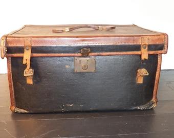 Antique, leather bound canvas trunk.