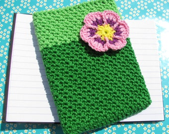 A6 note book, memo, journal with green cover and flower application.