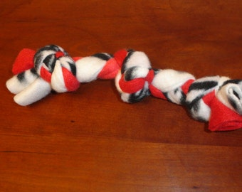 Braided fleece dog toy  8 to 12 in. long for the  small dog / puppy
