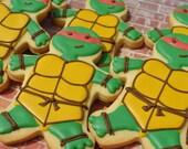 A dozen of teenage mutant ninja turtle inspired cookies! Option to add pizza or manhole cookies!
