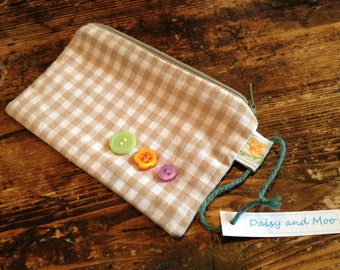 Handmade purse with button detail and contrasting fabric lining