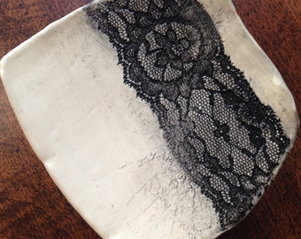 Handmade ceramic dish with lace impression.
