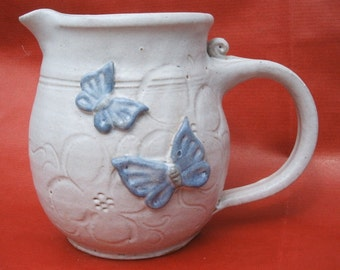 Stoneware jug, hand thrown and decorated, 1/2pt capacity 12cmx8cm