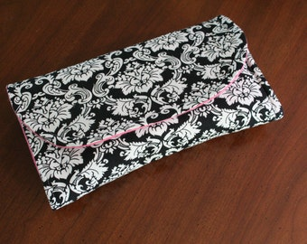 All-in-One Diaper Clutch with Built in Changing Pad - Travel clutch and changing pad - Black and White with Pink Lining