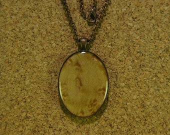 Birdseye Maple wood, resin encased in antique bronze finish pendant bezel with chain