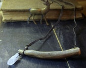 THE WANDERER . Handmade Boho Tribal Carved Deer antler necklace with rough crystal quartz. Unisex with brown suede cord.