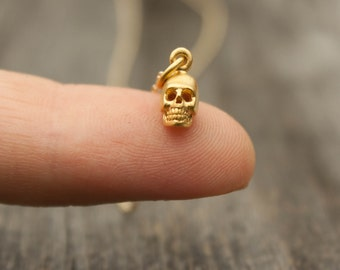 Tiny Gold Dipped Skull Necklace - Halloween Jewelry . Teeny Tiny Matte 24K Gold Dipped Skull Charm . Gold Skull Pendant