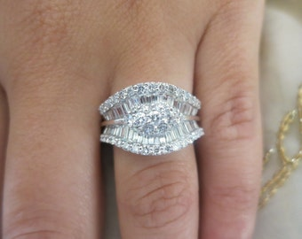 14K White gold baguettes and round diamonds ring.