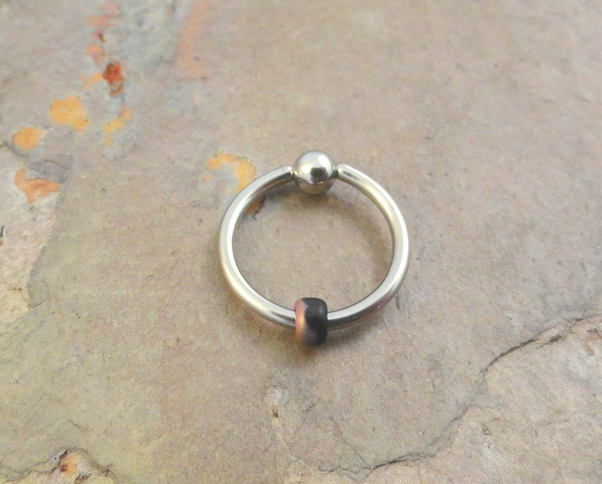 copper and black beaded cartilage hoop earring by