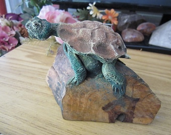 Handcrafted Turtle Figurine Set on a Natural Solid Wooden Beam