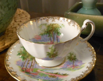 Vintage Aynsley Teacup and Saucer in Bone China Made in England White Scenery and Gold Accents