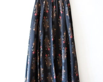Vintage 1970s black maxi skirt with abstract floral print size small