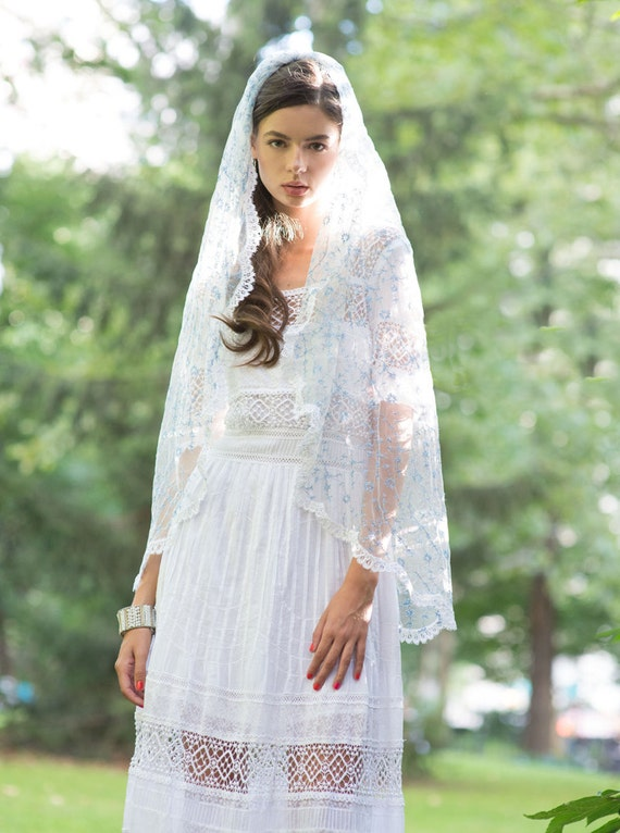 Lace trimmed bridal veil fingertip length with embroidered blue flowers and vines