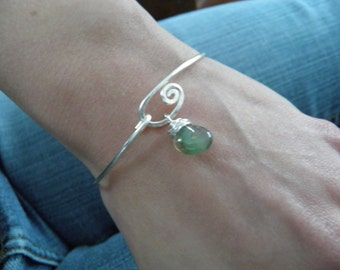 "Bracelet... ""Wave""... is a sterling silver bangle that is hammered by hand with a hook clasp and a beautiful agate stone charm."