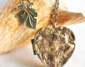 Music box locket,  heart shaped locket with music box inside, in bronze with Victorian maiden on front cover