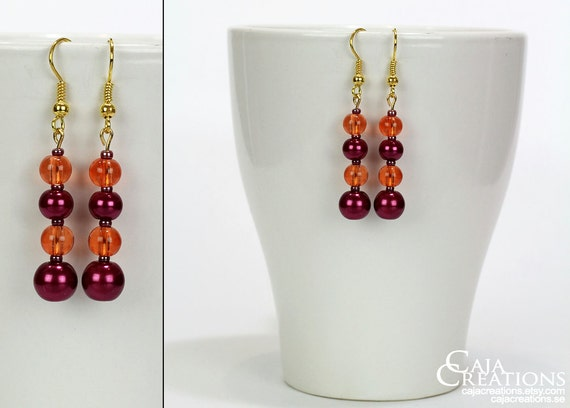 https://www.etsy.com/se-en/listing/191851056/long-ooak-earrings-in-orange-and