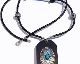Leather and turquoise pendant on braided leather strand.