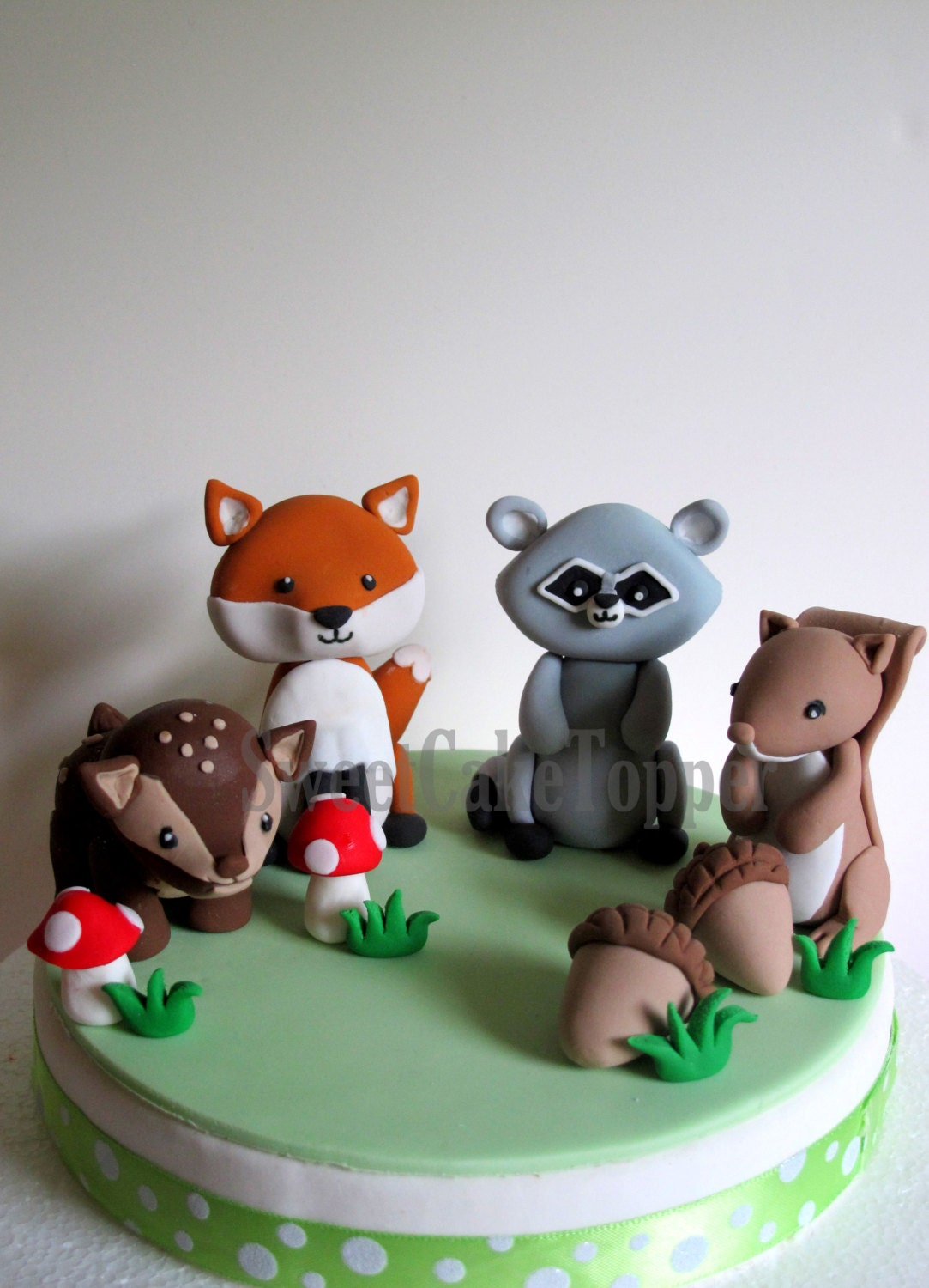Ready made woodland animal cake toppers fox raccoon for Animal cake decoration