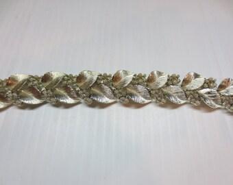 Lisner signed bracelet in silver tone leaf and berry design